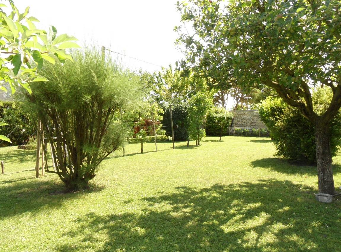 Character stone Charente property with a landscaped garden and outbuildings
